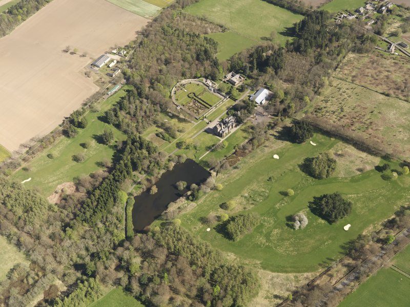 Oblique aerial view of Guthrie Castle Golf Course, taken from the SW.