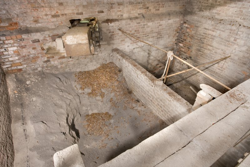 Interior. Hopper area, Hopper 1. Processed and screened  clay dust was deposited to await dispatch by (latterly) lorry. There wer 9 chutes altogether which were opened and closed using levers below in the undercroft.