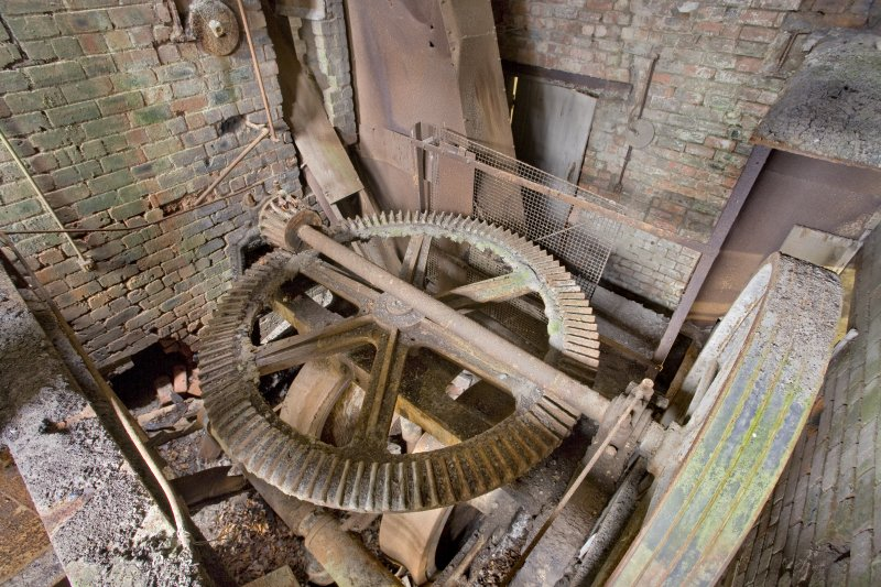 Interior. 'Old' Incla Pan Mill of c. 1911. This area had been upgraded, probably in the 1930s. The return chute for material that would not go through the screen ias visible alongside the larger casing for the bucket elevator that carried the milled clay dust to the screen.