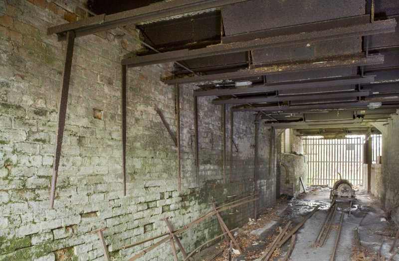 View from north of Hopper no.1 undercroft. Note the levers which oped up the hopper compartment to allow the clay dust to fall into railway wagons or (latterly)  ?lorries at the south end.
