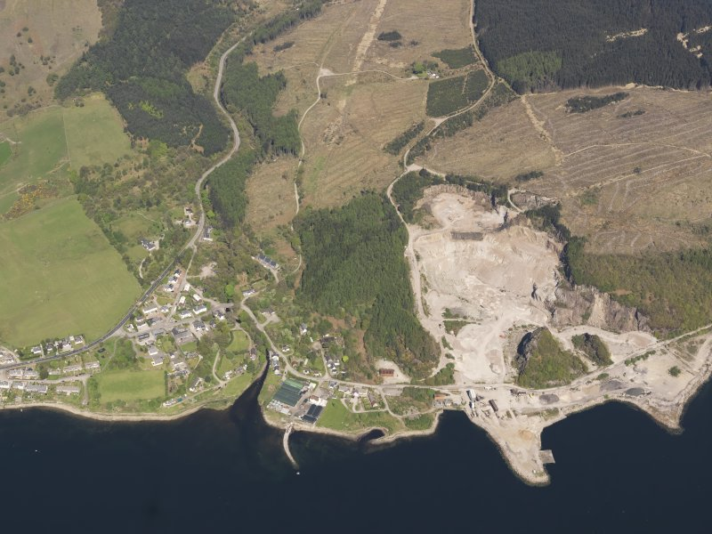 General oblique aerial view of Furnace village with the granite quarry adjacent, taken from the SSE.