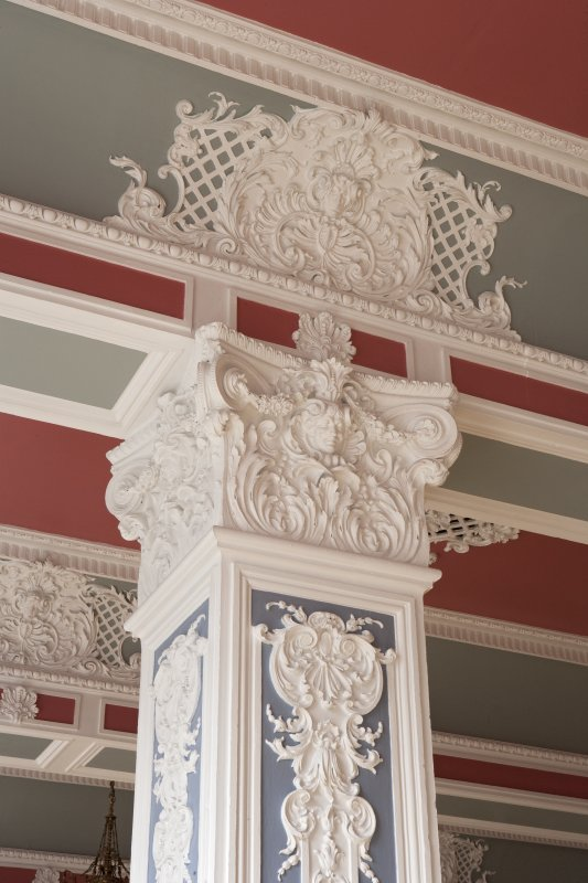 Interior. Ground floor.  Marryat Hall.  Detail of column capital with ceiling decoration above.