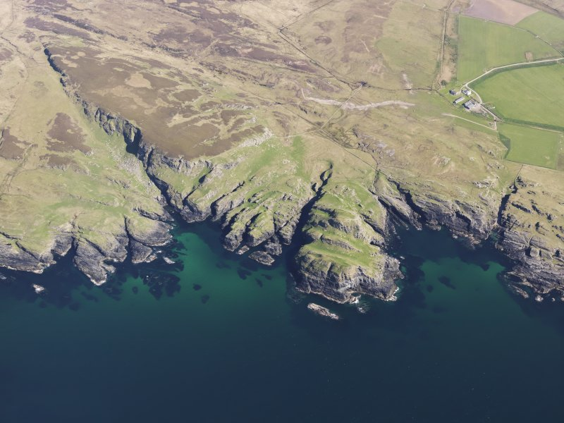General oblique aerial view of fort at Dun Bheolain, Islay, taken from the WNW.