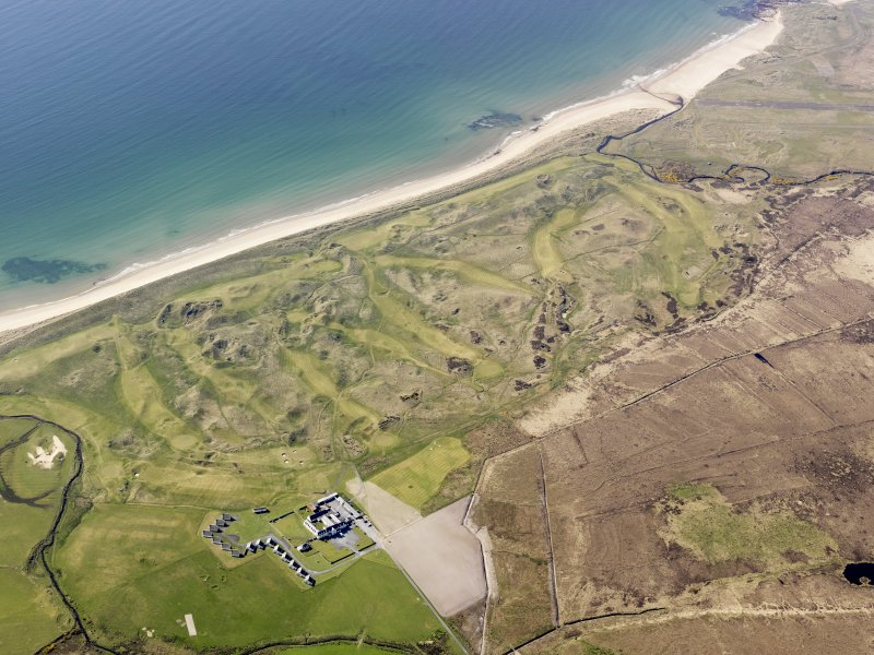 General oblique aerial view of Machrie Hotel with the golf course adjacent, taken from the ESE.