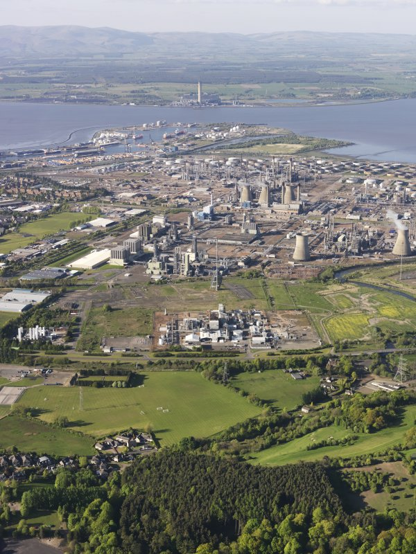 General oblique aerial view of Grangemouth Oil Refinery with Longannet Power station beyond, taken from the SSW.