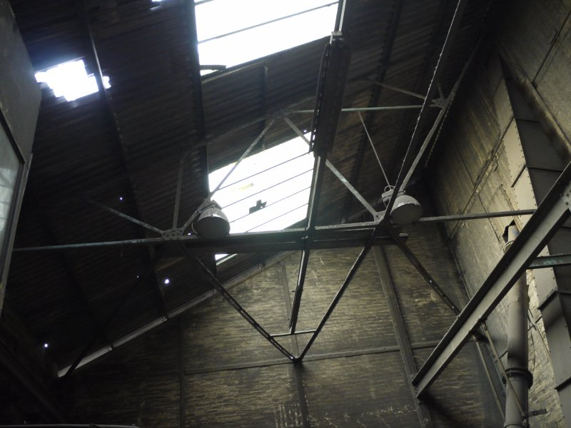 Pan House/ Machine Wing, ground floor. Interior. Pan house roof from east. This appears to be a half double inverted structure. Note the structure of the building - brick and steel frame from the ?early 20th century.