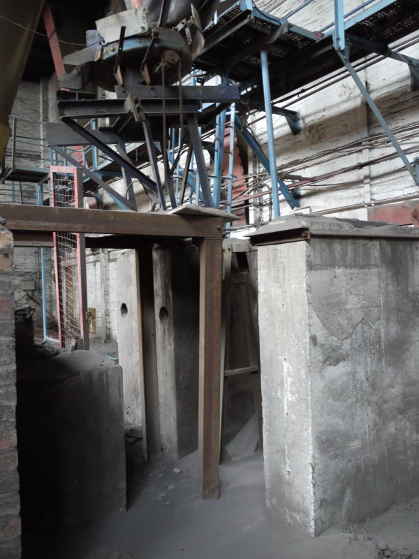 Pan House/ Machine Wing, ground floor. Interior. Hopper no.3. A conveyor carred the material from the hoppers towards the brick making machine  and onto the extruder, cutter and driers.