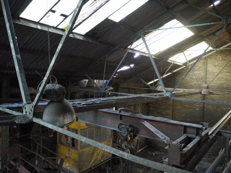 Pan House/ Machine Wing. Interior. Elevated view from north east. View of roof structure and 6 ton overhead travelling crane. The roof structure appears to a half double inverted type.