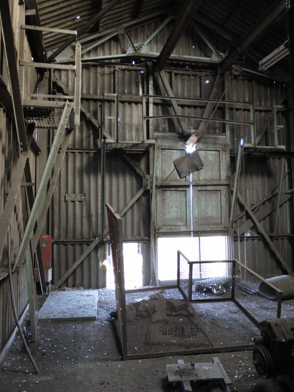 Pan House/ Machine Wing, 2nd floor/mezzannine, screen loft. Interior. View from west. A screen has been removed which would have served Hopper 1. Note the taking-in doors.