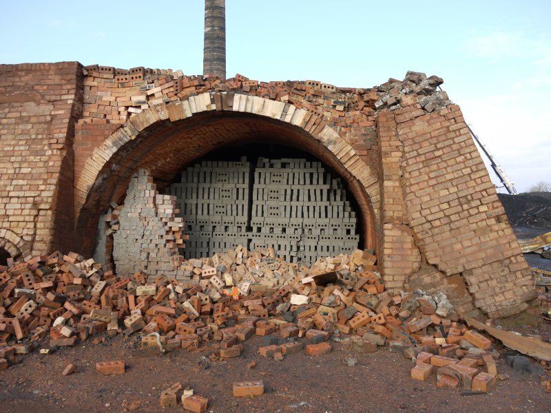View of unfired (green) bricks in partially demolished south east end of chambers of the gas-fired Hoffmann Continuous Kiln at centred NS94470 67952. This kiln could hold 380,000 bricks.