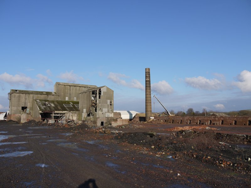 View from south west of 1964 gas-fired Hoffmann Continuous Kiln centred at NS94470 67952. To the left, Pan Mill and Crusher House. The Intermittent kiln is being dismantled in the background.