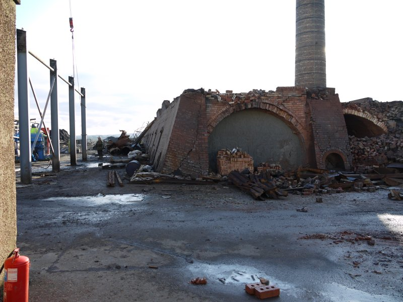View from north of north end of gas-fired Hoffmann Continuous Kiln centred at NS94470 67952. during demolition. This kiln could hold 380,000 bricks in total.