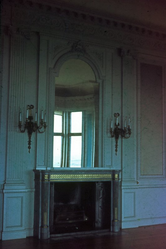 Carbisdale Castle, Interior. Fireplace and ornamental mirror.