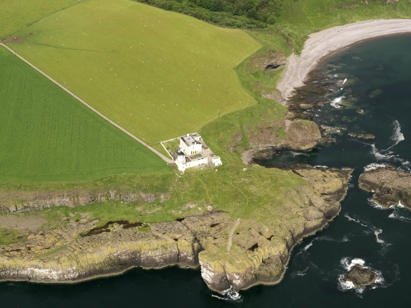 Oblique aerial view of Todhead Point Lighthouse, taken from the ESE.