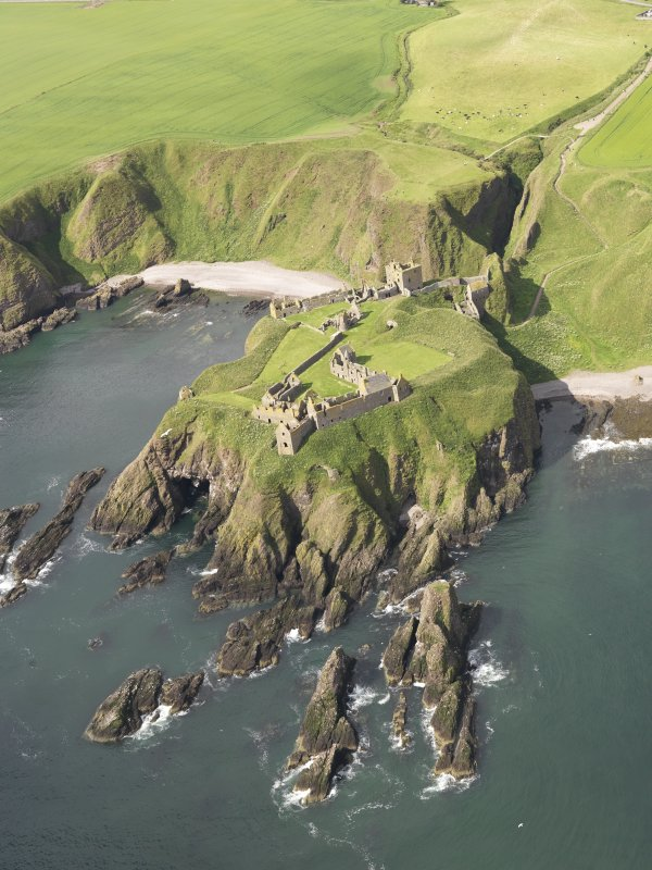 General oblique aerial view of Dunnottar Castle, taken from the ENE.
