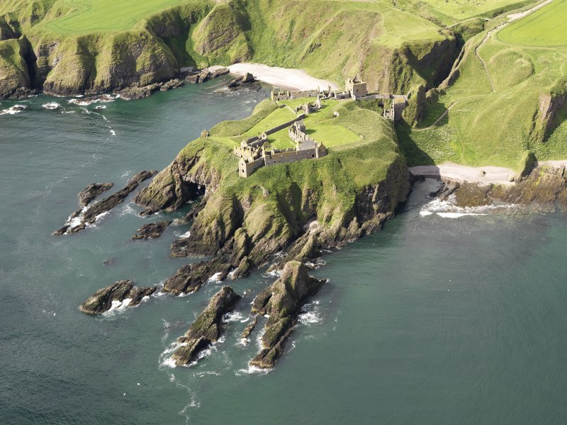 General oblique aerial view of Dunnottar Castle near Stonehaven, taken from the NE.
