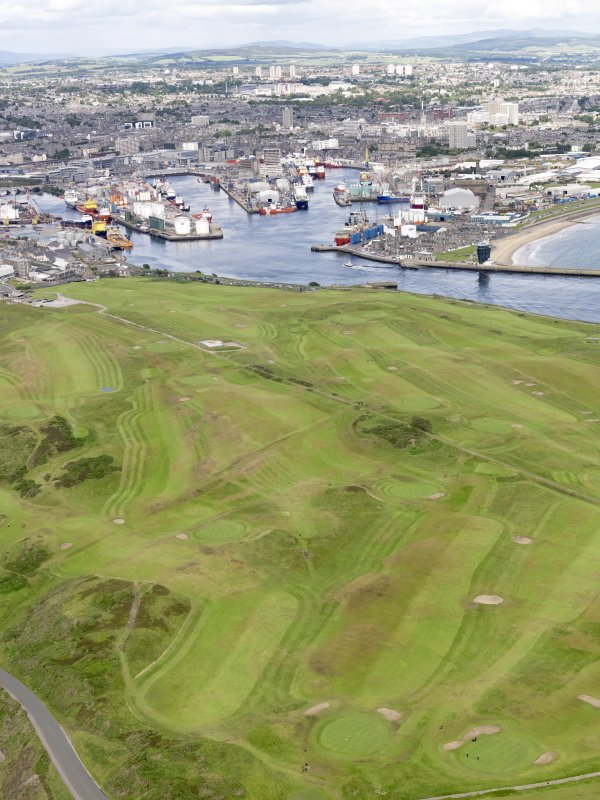 General oblique aerial view of Aberdeen Harbour and Balnagask Golf Course, taken from the ESE.