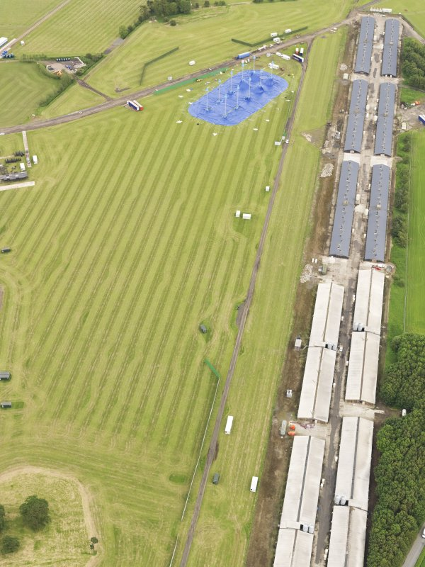 General oblique aerial view of Toll House Poultry Farm and the preparations for T-in-the-Park, taken from the W.