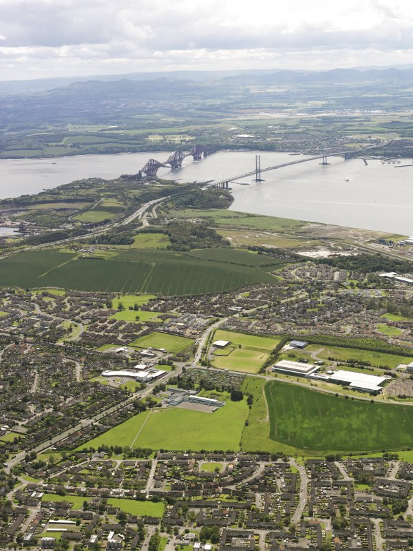 General oblique aerial view of Rosyth, Forth Rail Bridge and Forth Road Bridge, taken from the NW.