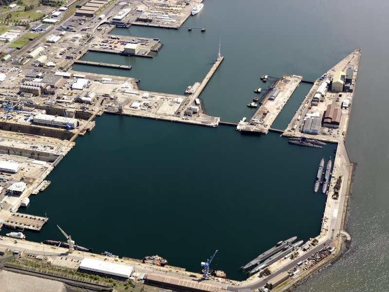 Oblique aerial view of HM Dockyard main basin Rosyth, taken from the W.