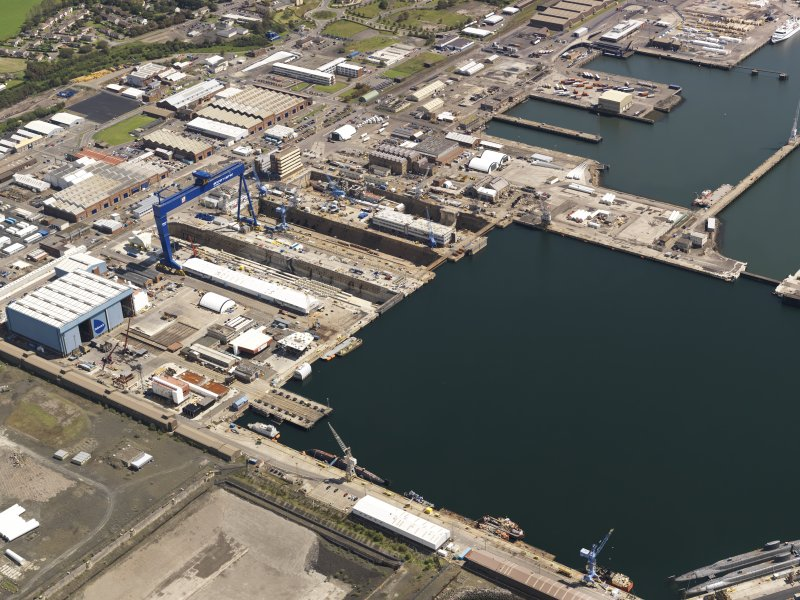 Oblique aerial view of HM Dockyard main basin Rosyth, taken from the WSW.
