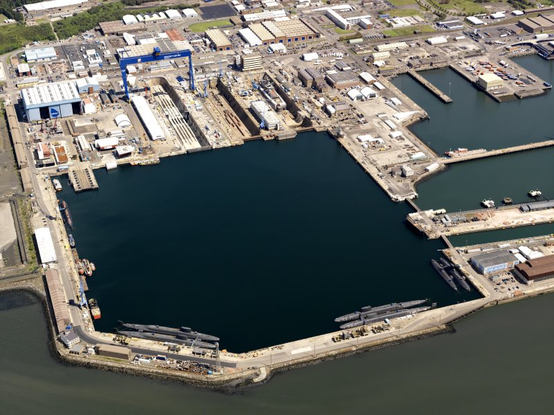 Oblique aerial view of HM Dockyard main basin Rosyth, taken from the SW.
