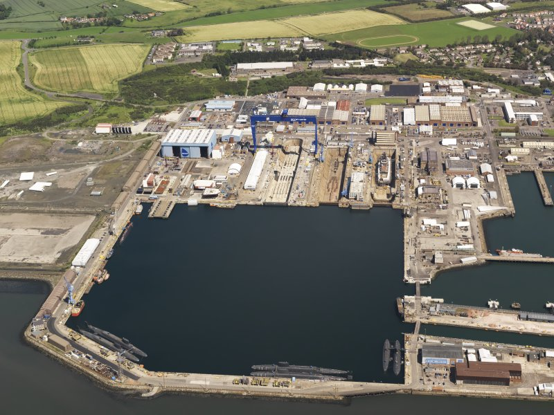 Oblique aerial view of HM Dockyard main basin Rosyth, taken from the SSW.