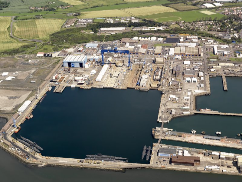 Oblique aerial view of HM Dockyard main basin Rosyth, taken from the S.