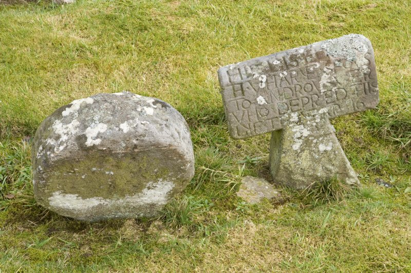 Detail of Round headed and T shaped gravestones within the burial ground to the south east of the church