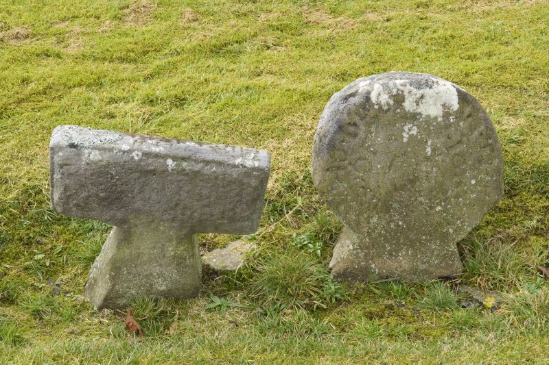 Detail of Round headed and T shaped stones within the burial ground to the south east of church
