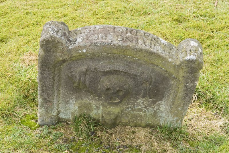 Detail of skull and crossbones and winged hour glass on gravestone to the south of the church