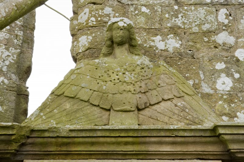 Detail of angel carving to head of John Orr monument, adjacent to the south wall of the church