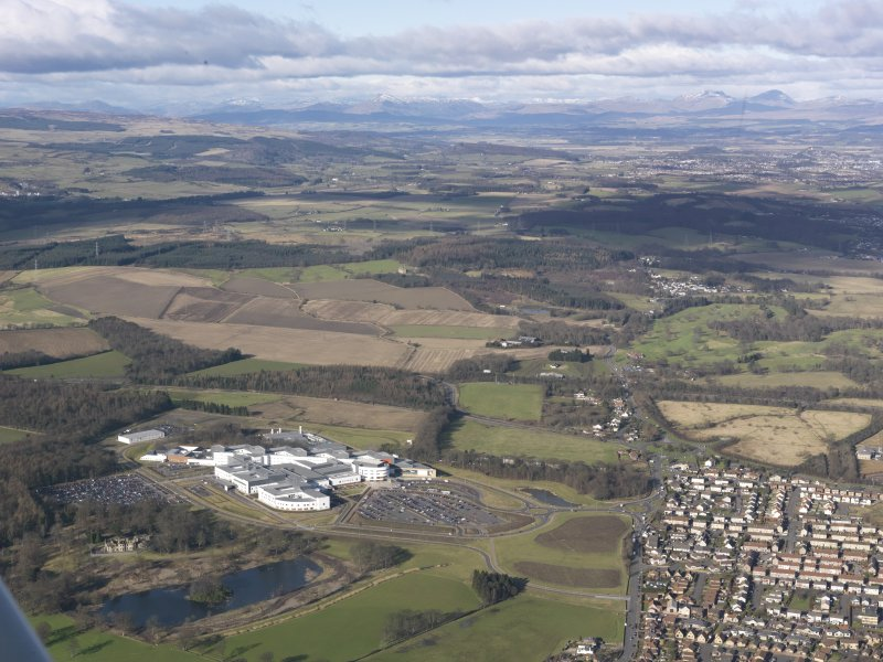 General oblique aerial view of the Upper Forth Valley with the Forth Valley Hospital at Larbert in the foreground, taken from the SSE.