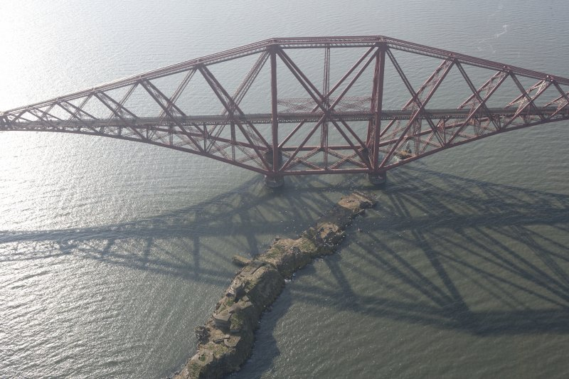 Oblique aerial view of one of the spans of the Forth Rail Bridge with Inch Garvie in the foreground, looking WSW.