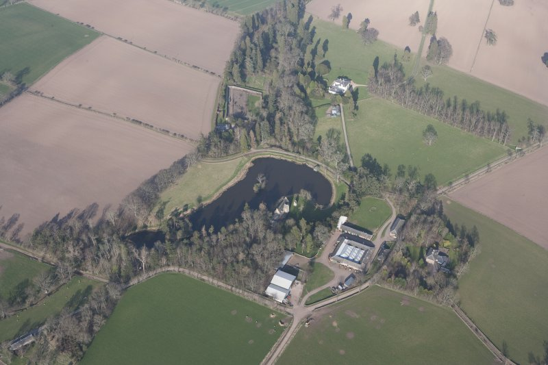 Oblique aerial view centred on Ecclesmagirdle House, looking NE.