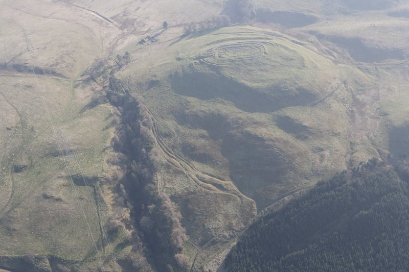 General oblique aerial view of Castle Law fort and the enclosures and trackways, looking SSW.