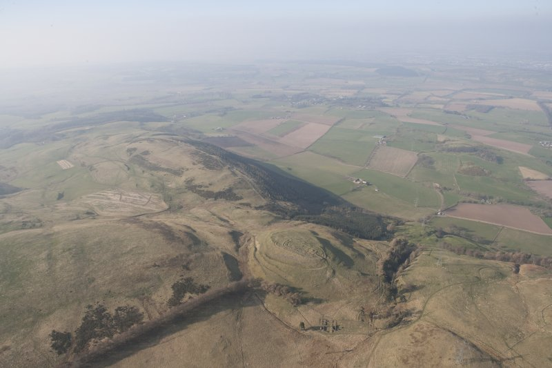 General oblique aerial view of Castle Law fort with Strath Earn and Forgandenny beyond, looking WNW.