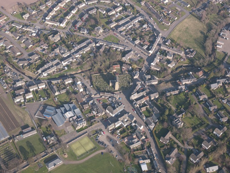 Oblique aerial view of Dunning village, looking E.