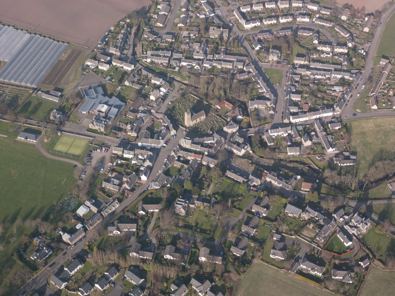 Oblique aerial view of Dunning village, looking NE.