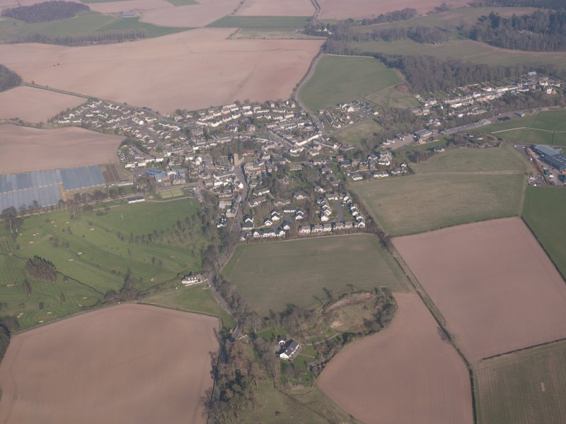 General oblique aerial view of Dunning village with South Lodge, Duncrub House in the foreground, looking N.