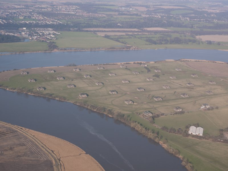 Oblique aerial view of the Royal Naval Armament deport at Throsk, looking NE.