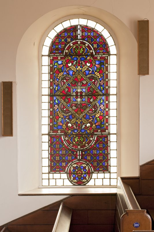 Interior. Balcony level, detail of stained glass window to west of pulpit