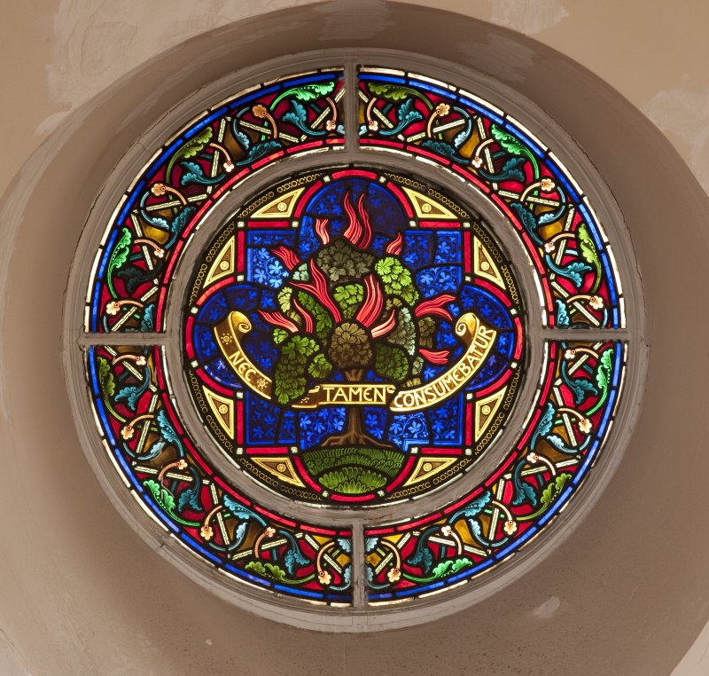 Interior. Balcony level, detail of circular stained glass window to west of pulpit
