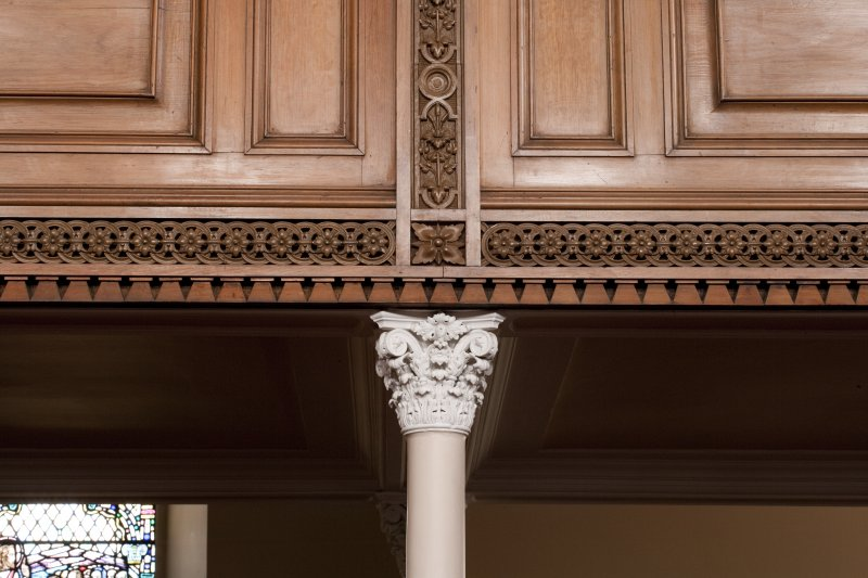 Interior. Detail of column capital and decoration on balcony front