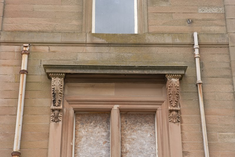Detail of carved lintel on west side, south facing window
