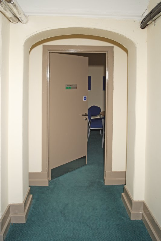 Interior. Basement. Detail of door within recessed arches.