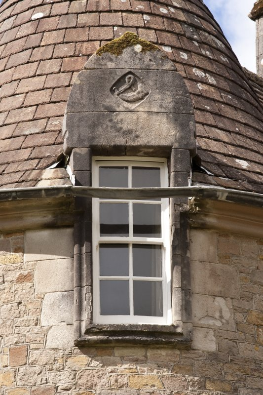 Detail of east dormer window with carved stone pediment at 2nd floor level of south facade, Ardkinglas House.