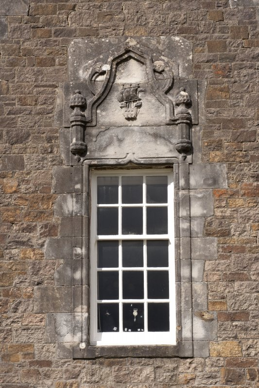 Detail of window with carved stone pediment on east gable of south facade