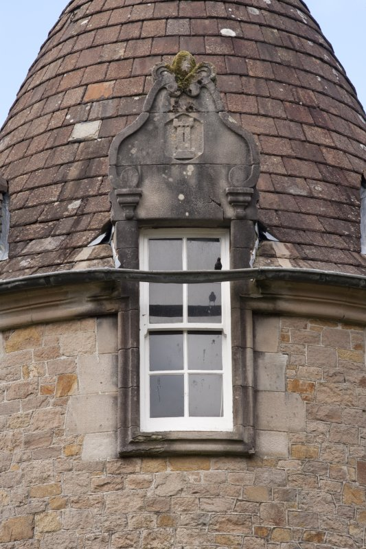 Detail of central dormer window with carved stone pediment at 2nd floor level of south facade