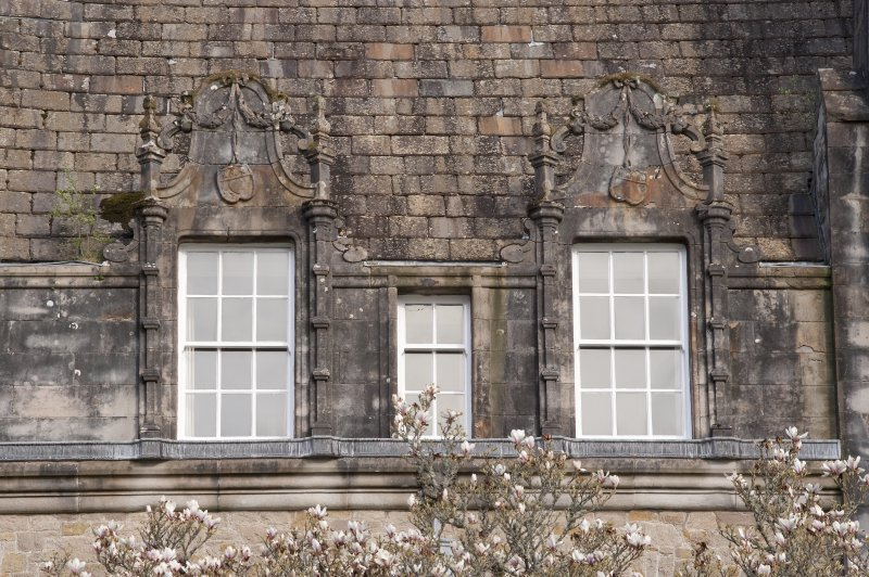 Detail of two dormer windows with carved stone pediments on west facade